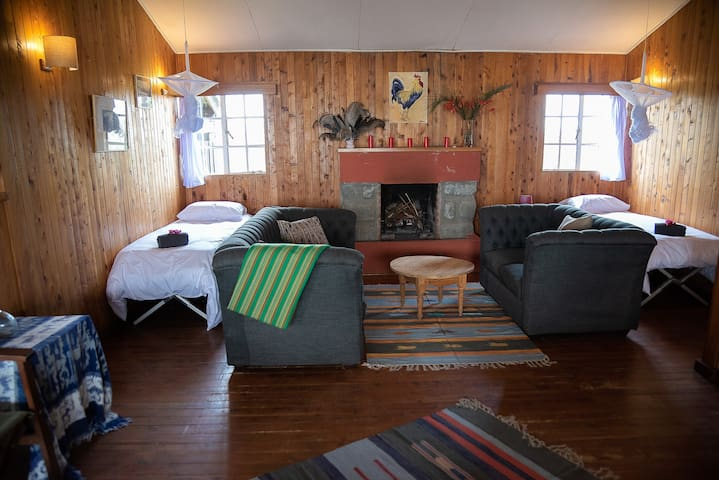 Living room with wood fire. Two camp beds can be setup on request for children or extra guests.