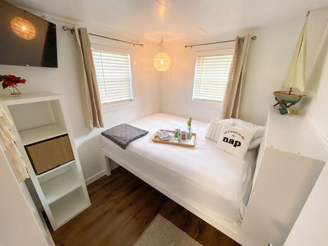 The bedrooms feature a queen bed and 32 inch Smart TV.