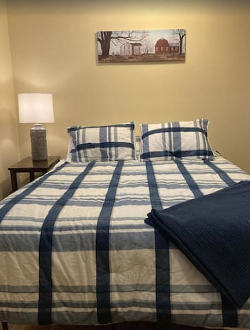 Ossipee Lake Bedroom: located on the ground level.  This room has a queen bed and radiant heat in the floor to keep your toes warm in the winter.