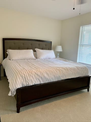 First floor King bedroom features new Nectar mattress, Egyptian cotton sheets, & smart TV!