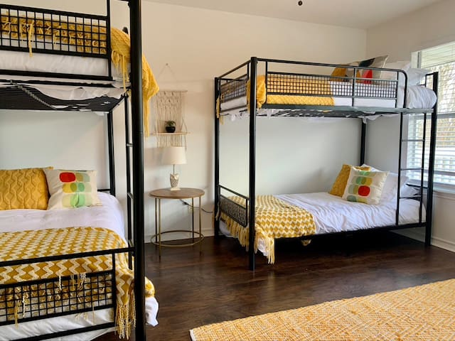 Upstairs bunk room has private door to  balcony with beautiful hill country views.