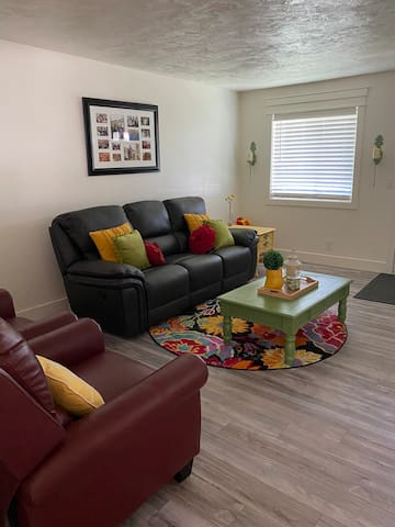 Living room has 2 very comfortable recliners as well as recliners on each end of the sofa.