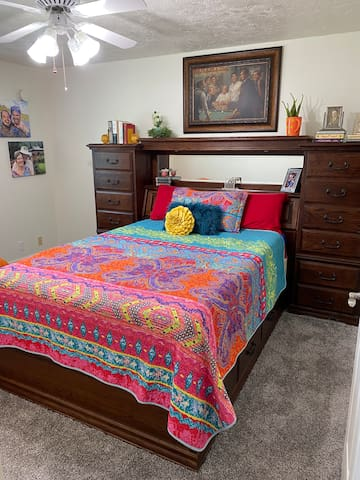 Comfortable queen bed with drawers below and drawers in the headboard! Also a walk in closet.