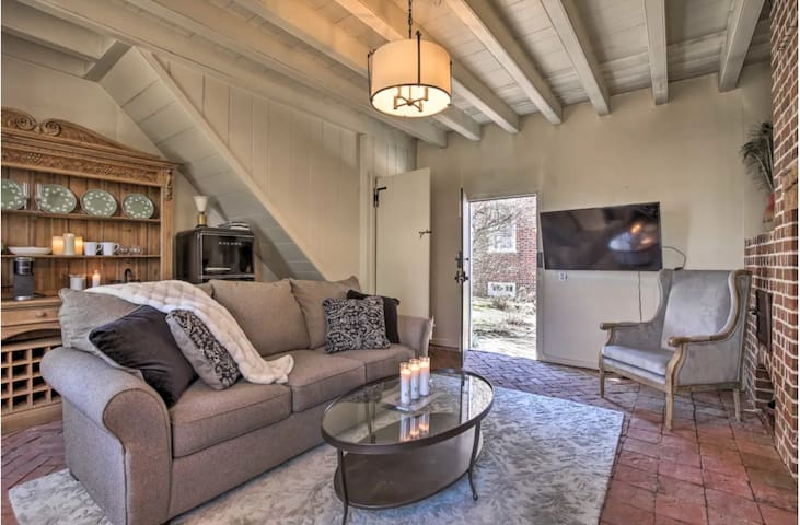 Rustic and historic cottage has brick floors embedded in historically correct sand base.  Queen pullout sofa.