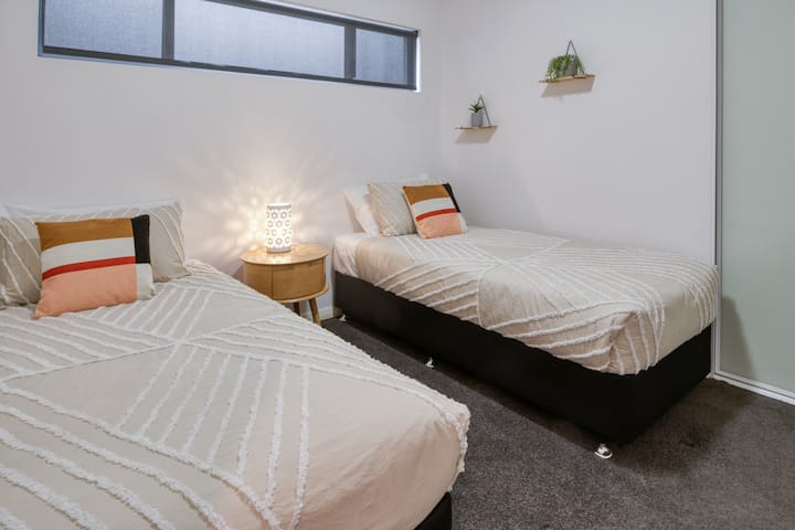 The third bedroom comes fitted with two single beds, ideal for those travelling in a group or with the kids.
