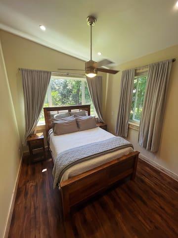 Second bedroom with queen bed. Garden views.