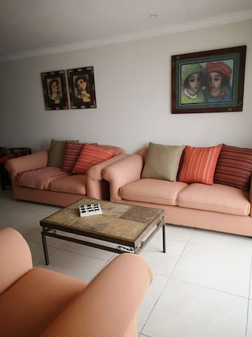 Living area with TV. Basic DSTV packet. You are welcome to bring your own simcard.