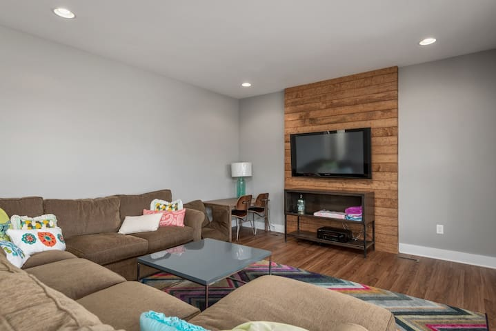 Bottom floor has another large living room with seating for 6.    Smart TV.