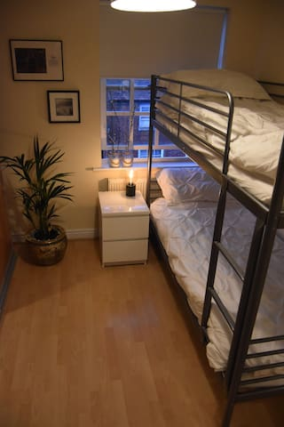 Second bedroom is equipped with sturdy bunk beds for kids or adults.   Also includes wardrobe storage.