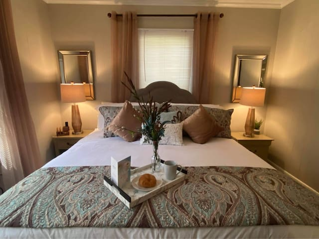 The main bedroom is as comfortable as it seems. It's furnished with a king sized bed and two nightstands.   All bedrooms and the living room have smart televisions, WIFI, free Netflix, and access to any of your subscribed streaming apps.