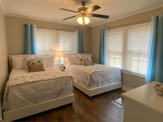 The second bedroom has two double beds with Serta mattresses..  In addition, Two fold-away beds available in the closet for additional guests.  Each has memory foam mattresses.