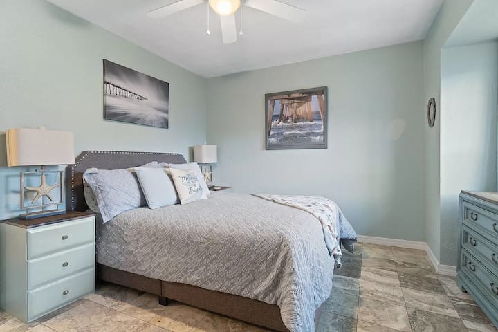 Second bedroom with large bay window and smart TV. On wall are pictures of the island's 2 public piers!