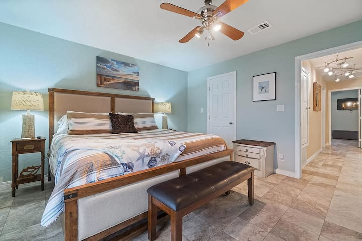 Unwind in the master bedroom with ultra comfy king bed and private waterfront balcony