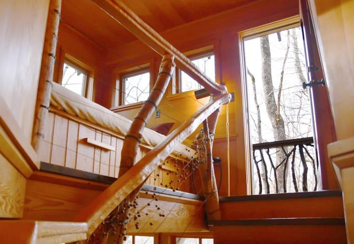 Bedroom and second floor balcony door.
