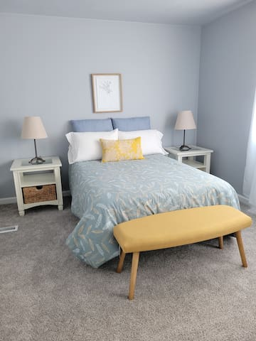Tranquil master bedroom with all new linens, a double bed, two closets and a vanity/workspace