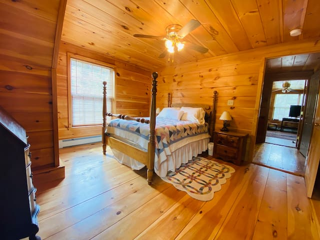 A full size bed in one of the three upstairs bedrooms.