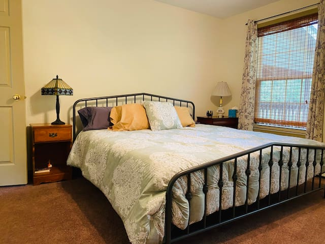 First floor bedroom with a king bed.