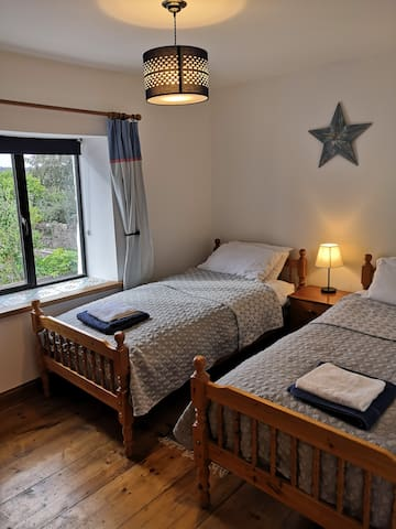 Twin room with adult sized single beds