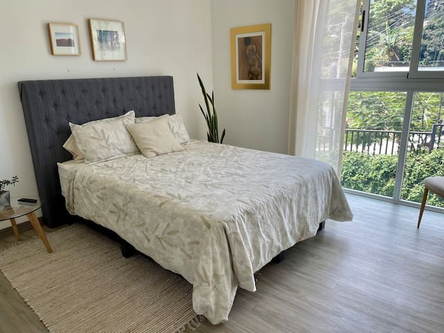 Secondary bedroom with queen bed and bathroom.