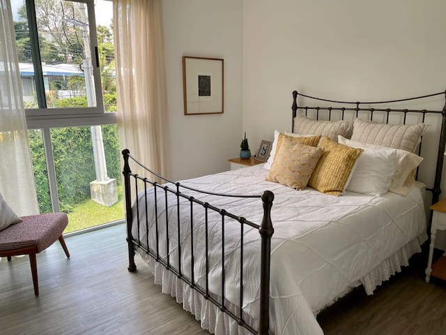 Main bedroom with queen bed and privet bathroom.
