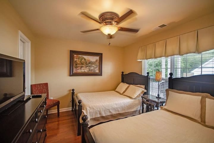 Second room with 2 Full size beds and choice of a firmer or softer mattress.  Also has a walk in closet which stores the iron and ironing board.