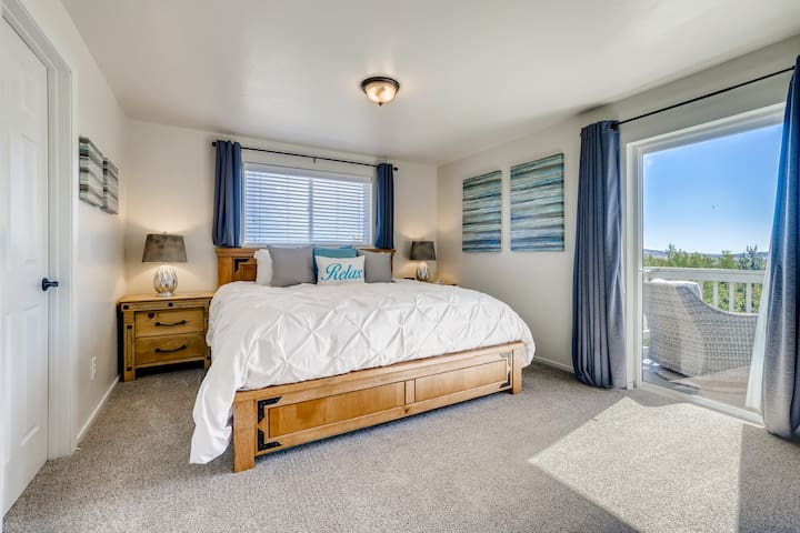 Master bedroom, king bed, attached bathroom with shower and tub, patio with seating