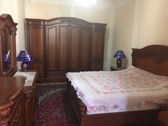 The spacious bedroom with a king-size bed.   - TV (upon request)  - Closet  - Vanity table - Drawer