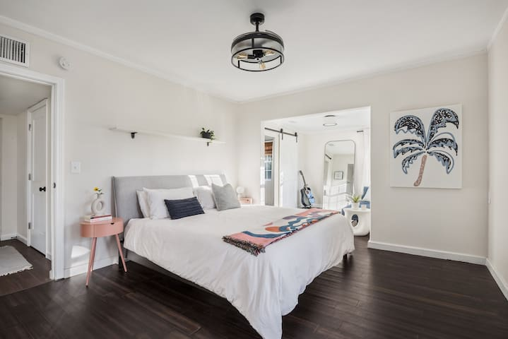 The primary bedroom is on the first floor, and has a separate sitting area, walk in closet, king size bed, and of course: spectacular views of the lake.