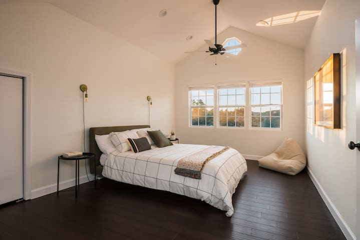 This second floor bedroom has a queen size bed with fresh linens and a great view.