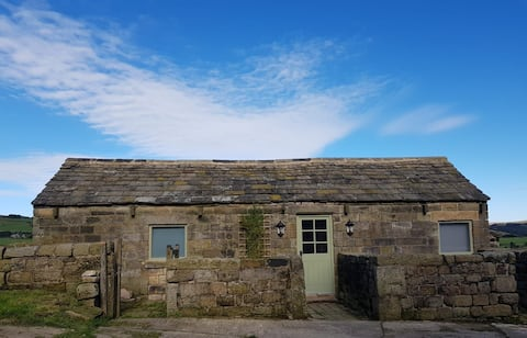 Rural converted piggery with wood-burning stove