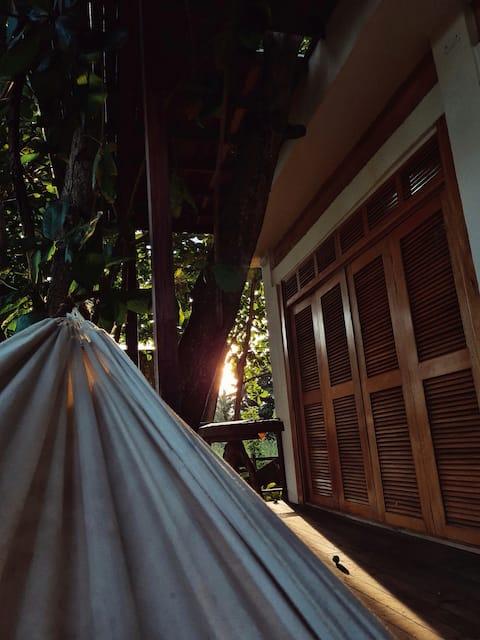 Encantadora casa Frente al mar c/Aire bajo arboles