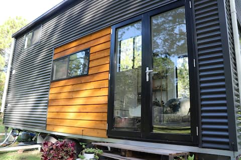 """Go """"off the grid"""" in a Tiny Home on wheels."""