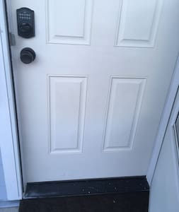 Front door has a small threshold when entering the unit