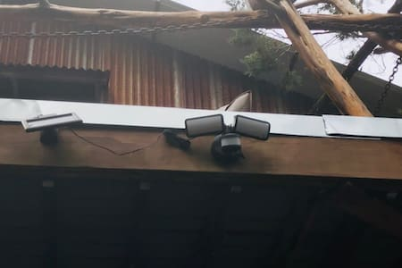 Two large flood lights, motion activated.  Another, smaller motion activated light, just above entry door.