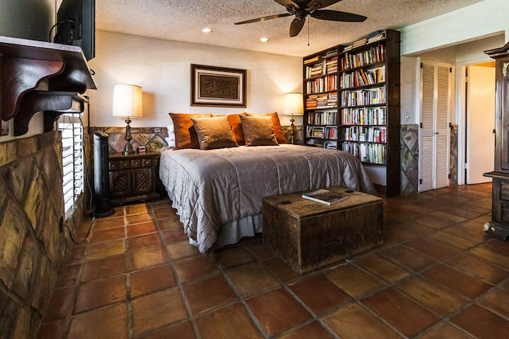 Master bedroom with a king-size bed