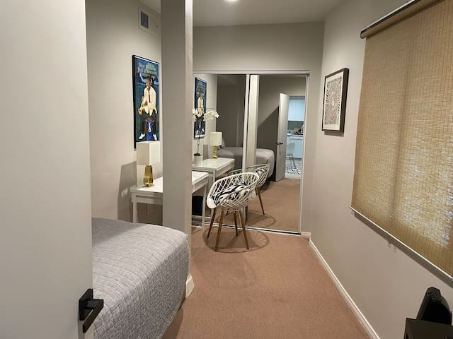 Bedroom desk with chair and spacious closet with full length mirror.