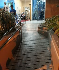 Ramp for wheel chair accessibilty and 24 hr security guard task to assist when requested by guest.