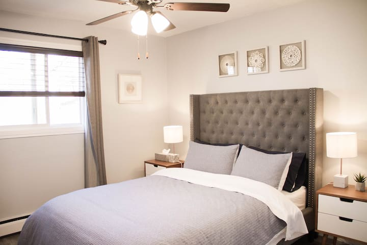 Relax in this comfy queen with simple decor, newly installed ceiling fan light for those hot days.