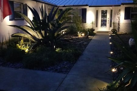 Front entryway and walkway iilluminated with solar landscape lighting.