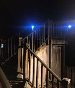 Motion-activated exterior lighting and solar-powered, motion-activated pathway lights on the stairs. We also have a motion-activated porch light above the front door of the unit.