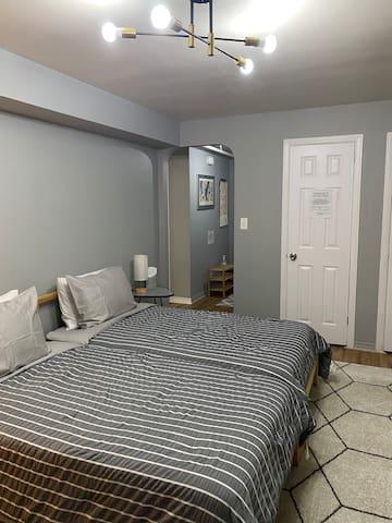 There are two roomy closets with hangers to store your clothes  as needed during your stay.   La habitacion o dormitorio consta de dos armarios con perchas  para guardar su ropa.