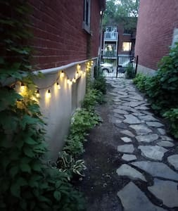 Pathway from street to stairs going to balcony entrance of apartment