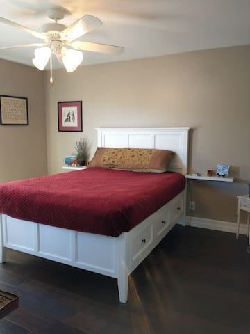 Master bedroom, bed has six drawers.