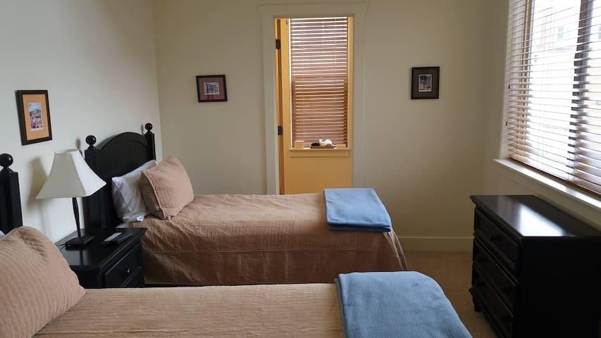 Bedroom #2 with two twin beds that can be converted to single King.  Full Private Bath Double height ceilings