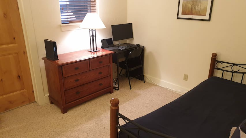 Work and Play with small desk & HD Monitor. Open Loft den area has day bed with pull out single bed (trundle). Great for kids.