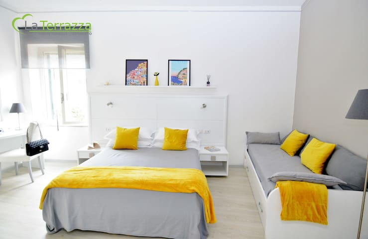 La Terrazza Family Holidays - Positano Room - Up to 4 beds.  SmartTvSat, Window, Air Conditioned, Warmer, Wi-Fi broadband. USB Sockets, Wardrobe, Desk, Sofabed, Safe and Mirrors.