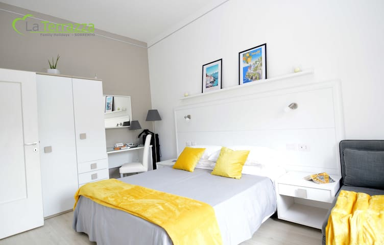La Terrazza Family Holidays - Amalfi Room - Up to 3 beds.  SmartTvSat, Window, Air Conditioned, Warmer, Wi-Fi broadband. USB Sockets, Wardrobe, Desk, Sofabed, Safe and Mirrors