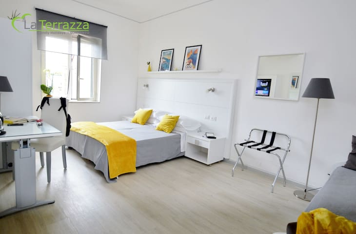 La Terrazza Family Holidays - Capri Room - Up to 4 beds.  SmartTvSat, Window, Air Conditioned, Warmer, Wi-Fi broadband. USB Sockets, Wardrobe, Desk, Sofabed, Safe and Mirrors.