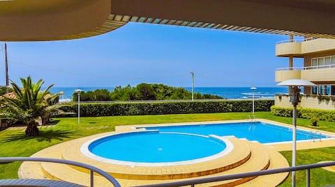 Beachfront apartment with pool.