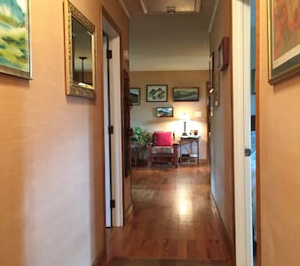 Wide hallway with no obstructions for accessing all rooms.